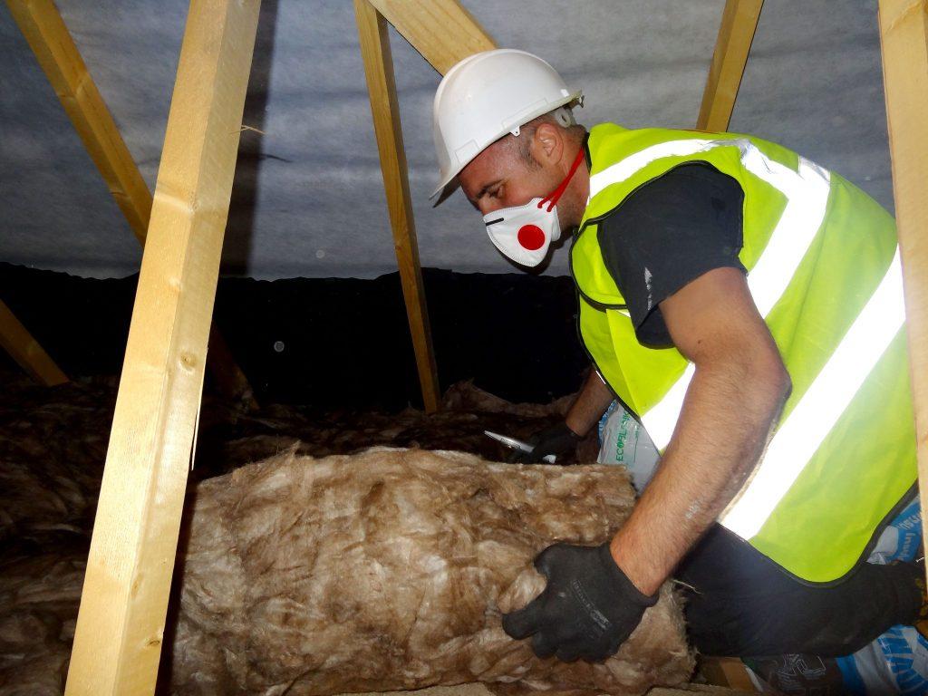 Loft insulation installing